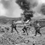 597px-Men_of_1st_Battalion_advance_past_a_burning_fuel_store_on_Pantelleria